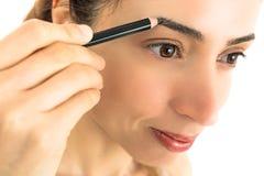 Close up of woman having make up Royalty Free Stock Image