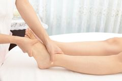 Close-up of woman having reflexology stock images