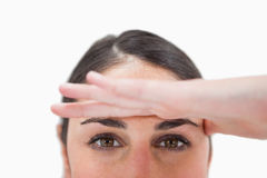 Close up of a woman with her hand on her forehead Stock Image