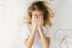 Close-up of a woman hiding in her bed at home Stock Photo