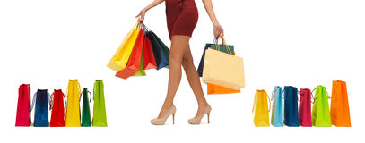 Close up of woman on high heels with shopping bags Stock Images