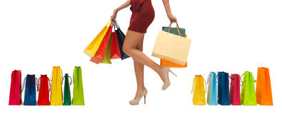 Close up of woman on high heels with shopping bags Royalty Free Stock Image