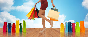 Close up of woman on high heels with shopping bags Royalty Free Stock Photos
