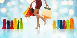 Close up of woman on high heels with shopping bags Stock Photography