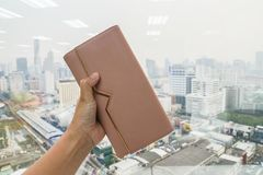 Close up woman hold cute leather wallet in left hand with city view royalty free stock image