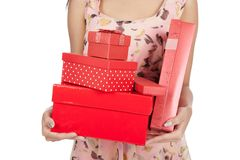 Close up woman hold many red gift boxs Stock Images