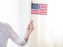 Close up of woman holding american flag in hand Stock Images