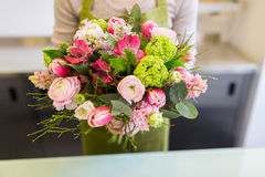 Close up of woman holding bunch at flower shop Royalty Free Stock Photos