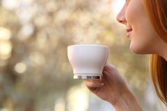 Close up of a woman holding a coffee cup Stock Photo