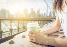 Close up on a woman holding coffee paper cup royalty free stock image