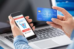 Woman Doing Online Shopping Using Credit Card. Close-up Of A Woman Holding Credit Card In Hand Doing Online Shopping Using Smart Phone stock images