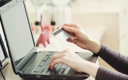 Close-up of woman holding credit card Stock Photo