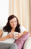 Close up of a woman holding a cup Royalty Free Stock Photography