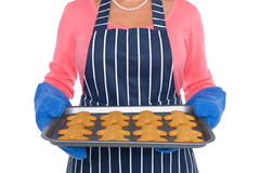 Close up of a woman holding freshly baked gingerbread men Stock Photography