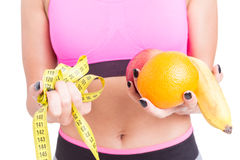 Close-up of woman holding fruits and tape line Royalty Free Stock Photography
