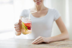 Close up of woman holding glass with fruit water Stock Photos