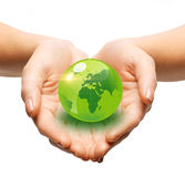 Close up of woman holding green globe in her hands Stock Photos
