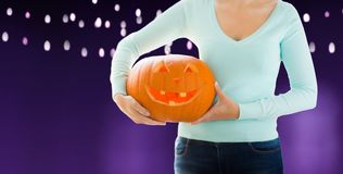 Close up of woman holding halloween pumpkin stock image