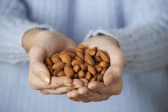 Close Up Of Woman Holding Handful Of Almonds Royalty Free Stock Photos