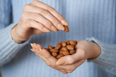 Close Up Of Woman Holding Handful Of Almonds Royalty Free Stock Photography