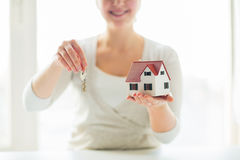 Close up of woman holding house model and keys Royalty Free Stock Images