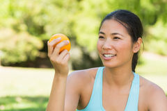 Close-up of woman holding orange in park Royalty Free Stock Images