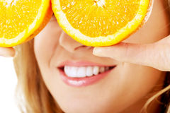 Close up woman holding oranges on eyes Royalty Free Stock Photo