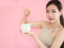 Close-up Woman Holding Piggy Bank,beauty girl saving money ,Putt. Ing Coin Stock Photography