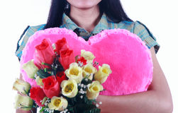 Close up woman holding pink heart and flowers Royalty Free Stock Images
