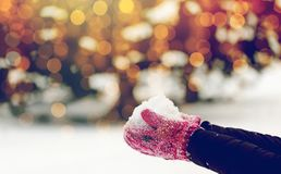 Close up of woman holding snow outdoors. Winter holidays, christmas and people concept - close up of woman holding snow outdoors Stock Photography