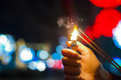 Close up of woman holding sparkler on the street. Closeup of Gir Royalty Free Stock Images