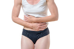 Close up of woman holding stomach in pain Royalty Free Stock Photo