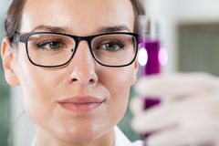 Close-up of a woman holding a test tube Royalty Free Stock Photos