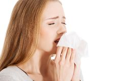 Close up woman holding tissue sneezing Royalty Free Stock Photography