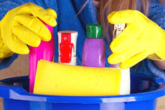 Close-up of woman holdinh basin with cleaning supplies Stock Image
