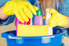 Close-up of woman holdinh basin with cleaning supplies Royalty Free Stock Images