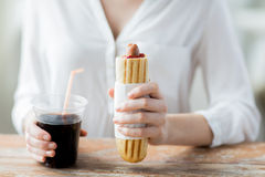 Close up of woman with hot dog and coca cola drink Royalty Free Stock Photos