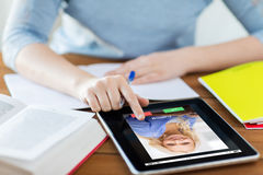 Close up of woman with incoming call on tablet pc. Business, education, technology and communication concept - close up of student women with incoming call on stock photography