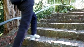 Close up woman jogging stairs stock video