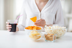Close up of woman with junk food and coca cola cup Stock Photo