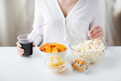 Close up of woman with junk food and cola cup Stock Photo