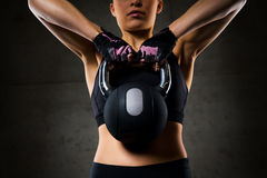 Close up of woman with kettlebell in gym Stock Images
