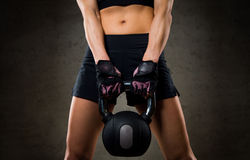 Close up of woman with kettlebell in gym Stock Image