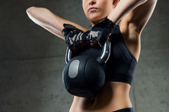 Close up of woman with kettlebell in gym Stock Photos