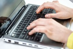 Close up of woman with laptop computer in office Royalty Free Stock Image