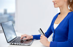 Close up of woman with laptop and credit card Royalty Free Stock Image