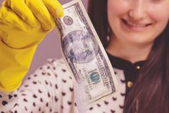Close up woman launder shady money as symbol of illegal cash and corruption. Selective focus on money.  stock photo