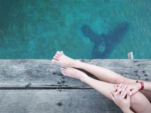 Close up woman leg and foot over blue sea. royalty free stock photos
