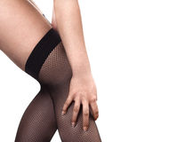 Close up of woman legs in fishnet stockings Royalty Free Stock Photography