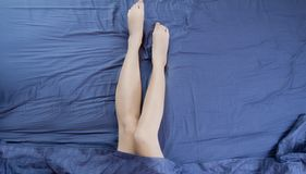 Free Close Up Woman Legs In Bed Under Blanket. Beautiful Shaved Legs After Spa And Bath Skin Care Treatment. Sleeping And Relax Time Royalty Free Stock Images - 147004549